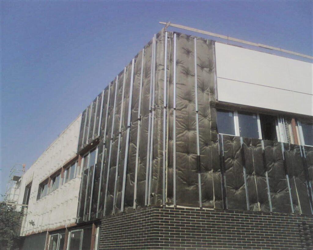 fachada edificio SATE aislamiento exterior para ahorro energético y limitación de humedades